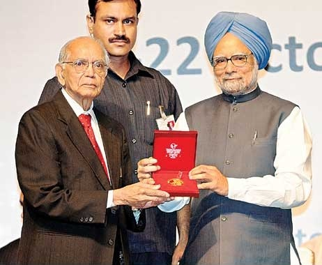 Thatha with Award from PM
